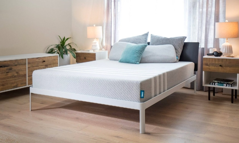 Leesa Mattress review - Leesa Mattress with pillows and lamp in a room - BedTester.com